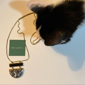 Gold, onyx and granite long necklace.